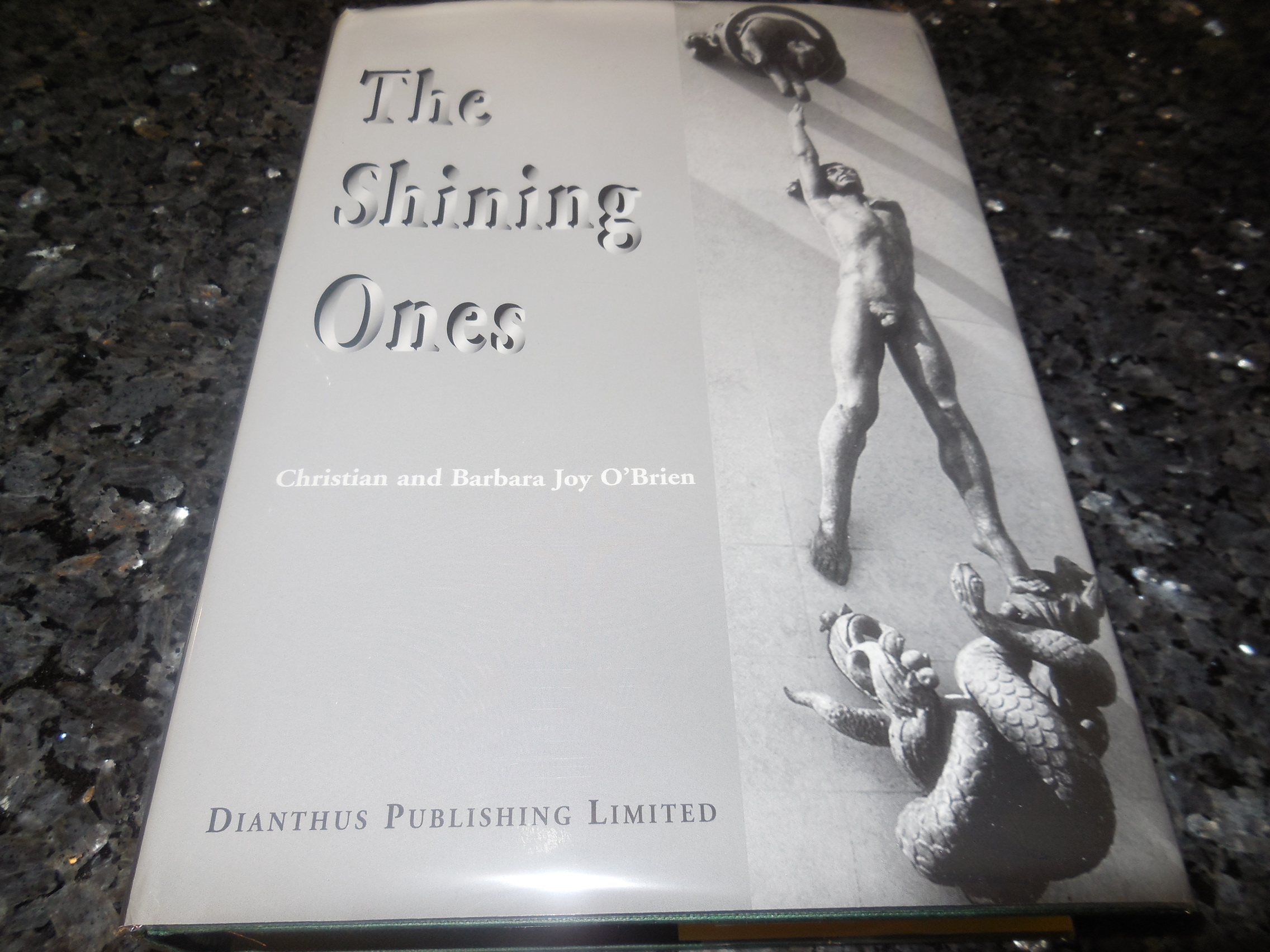 Image for The Shining Ones: An Account of the Development of Early Civilizations Through the Direct Assistance of Powers Incarnated on Earth from the Materio-Spiritual Planes of the Astral and Causal Regions